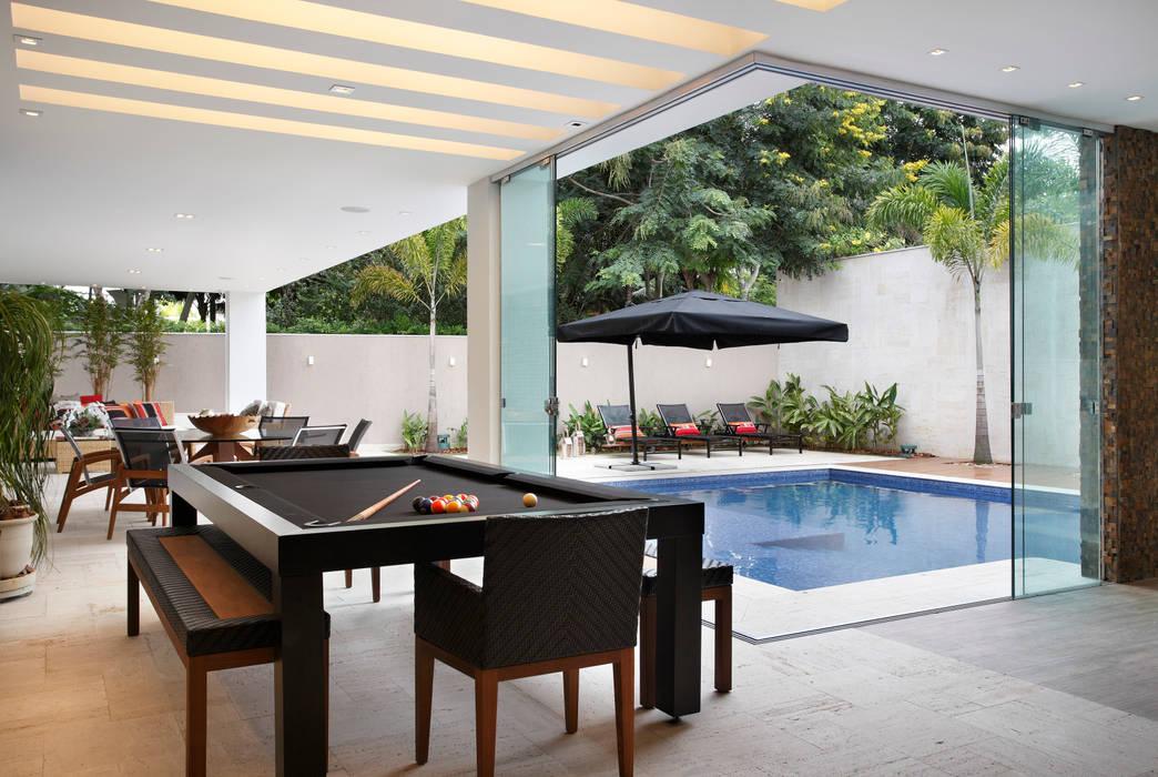 Varanda Gourmet : Terraços  por Arquitetura e Interior,