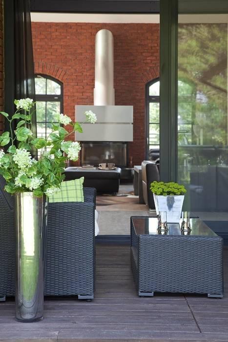 Balcones y terrazas de estilo industrial de RAJEK Projektowanie Wnętrz Industrial