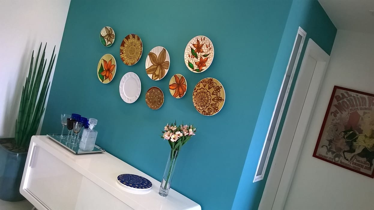 Cores e arte: Salas de jantar  por Fabio Pantaleão Arquitetura+Interiores,