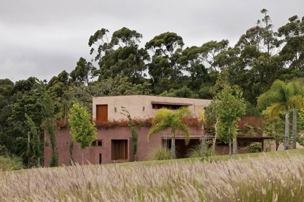 Residência Boa Vista Jardins clássicos por André Paoliello Paisagistas Associados Clássico