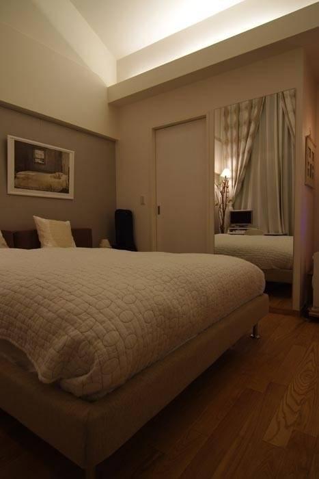 Camera da letto eclettica di Style is Still Living ,inc. Eclettico