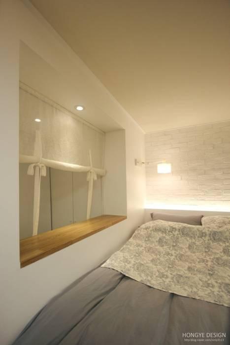 침실: 홍예디자인의  침실,