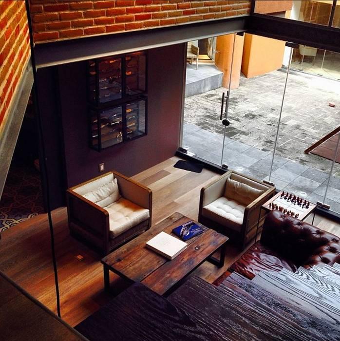 Salón Livings de estilo moderno de Quinto Distrito Arquitectura Moderno Ladrillos