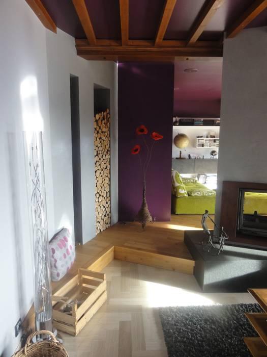 Le range bûche: Salon de style de style Moderne par CAP-D