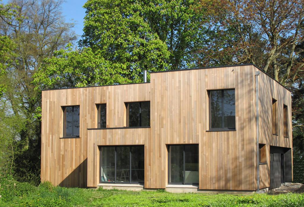 Casas modernas de F. DEMAGNY ARCHITECTE Moderno