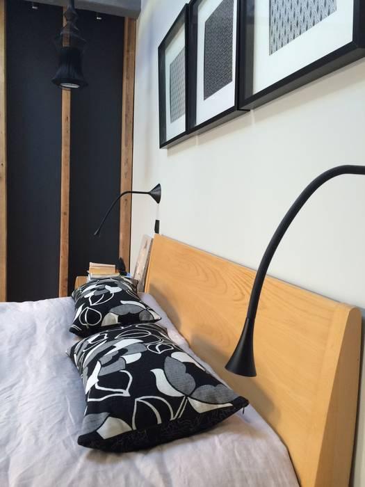 Zoom chambre côté liseuses: Chambre de style de style Moderne par Bulles & Taille-crayon