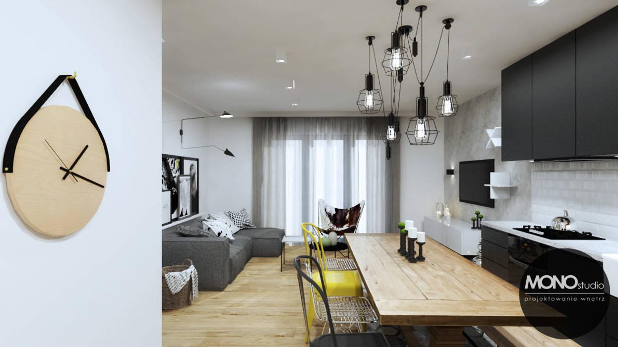 Industrialny charakter z ciepłem domowego ogniska: styl , w kategorii Jadalnia zaprojektowany przez MONOstudio,