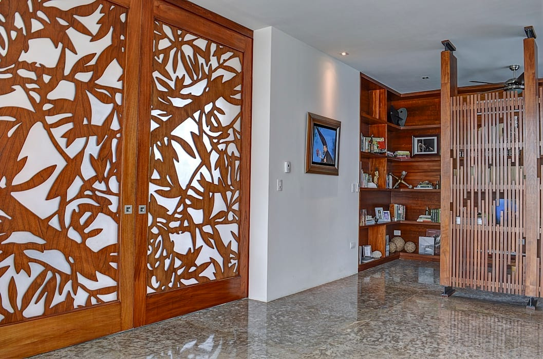 Tropical style windows & doors by Ancona + Ancona Arquitectos Tropical