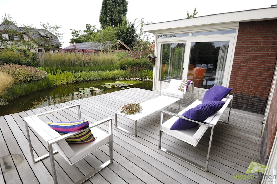 Country style garden by Visser Tuinen Country