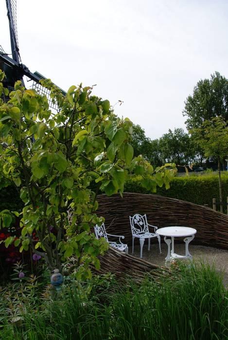 Knus zitje Moderne tuinen van Ontwerpstudio Angela's Tuinen Modern