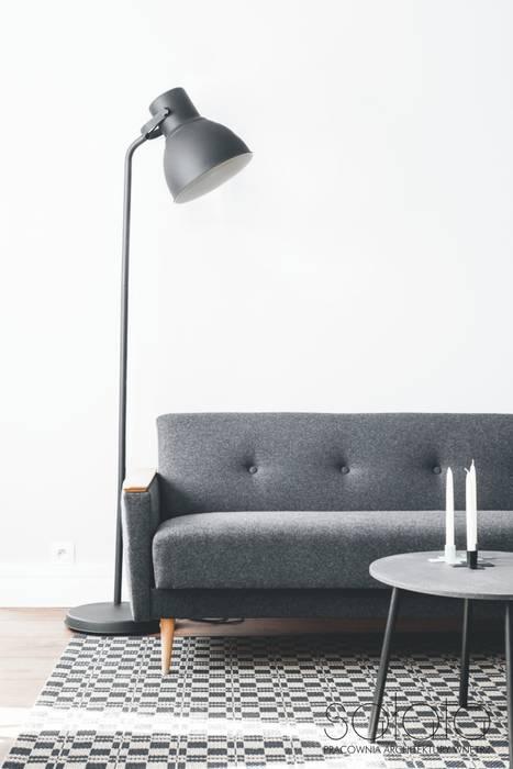 Mieszkanie w zabudowie wielorodzinnej, Szczecin.: styl , w kategorii Salon zaprojektowany przez Sałata-Pracownia Architektury Wnętrz
