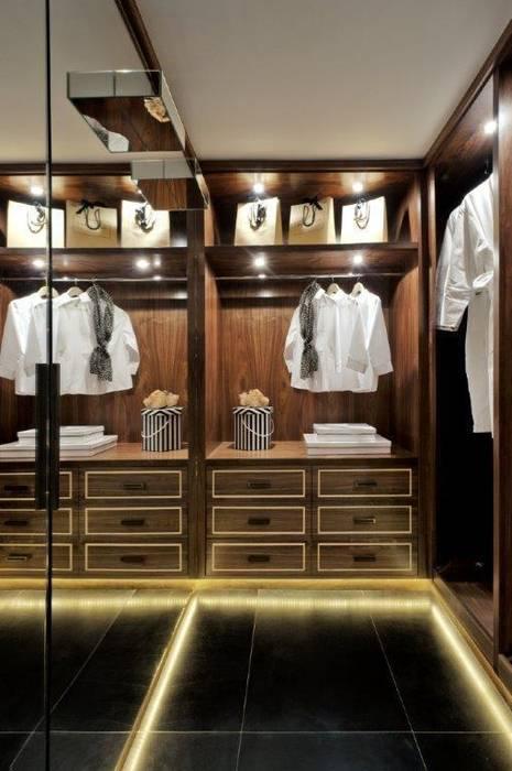 Leather Floored Walk-In Wardrobe Modern dressing room by homify Modern