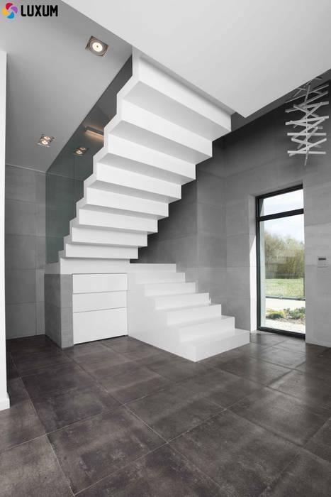 Idealny beton od Luxum: styl , w kategorii Salon zaprojektowany przez Luxum,Minimalistyczny
