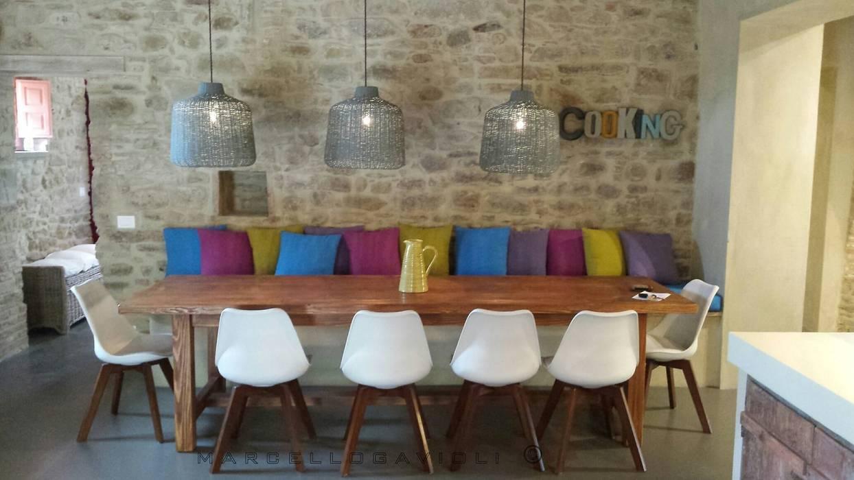 Comedores de estilo  por Marcello Gavioli, Rústico