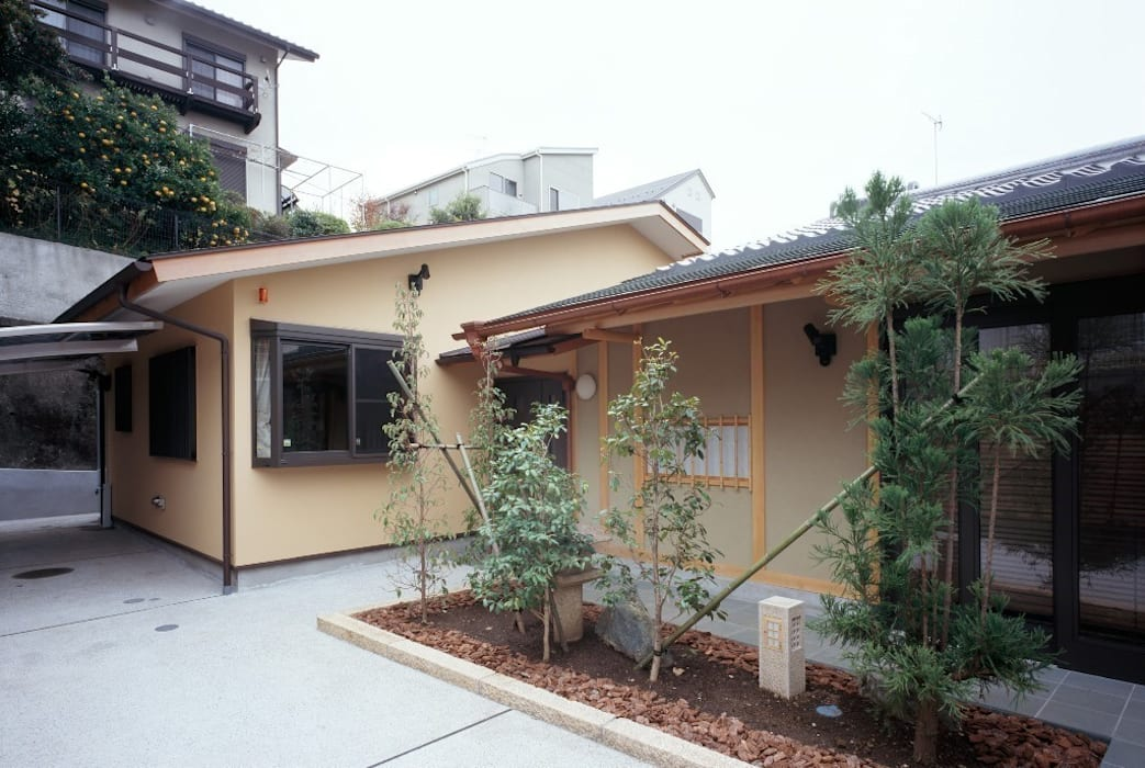 Casas de estilo asiático de 忘蹄庵建築設計室 Asiático
