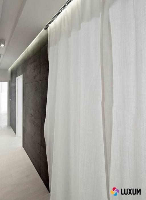 Beton architektoniczny: styl , w kategorii Salon zaprojektowany przez Luxum