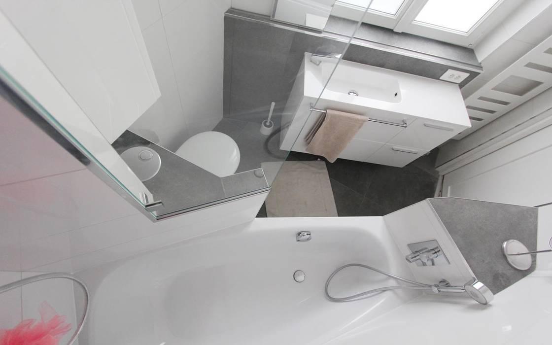 Salle de bain terminée: Salle de bains de style  par les bains et les cuisines d'Alexandre