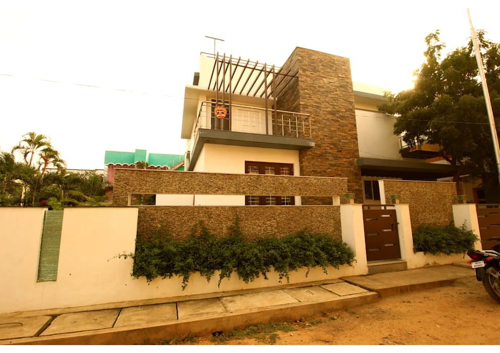 Modern houses by Aadyam Design Studio Modern Stone
