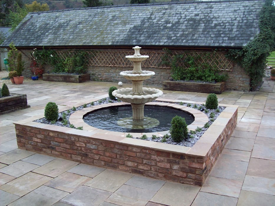 Stone Water Fountain:  Garden by Unique Landscapes