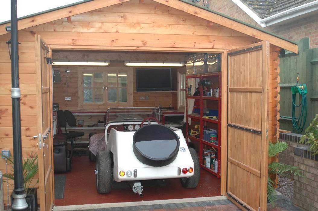 Wooden garages Garajes y galpones de estilo clásico de Quick garden LTD Clásico