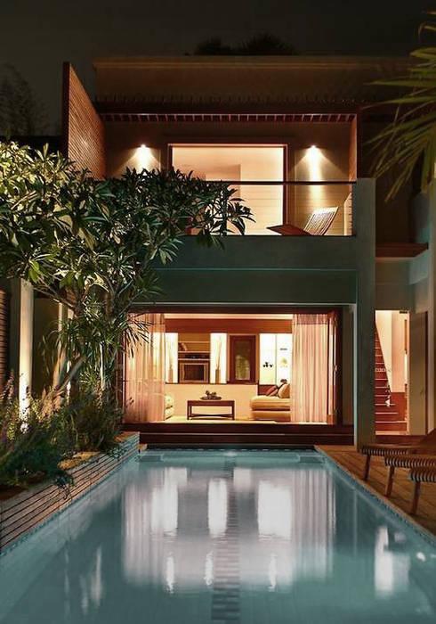 Nathalie: Maisons de style de style Moderne par RencontreUnArchi