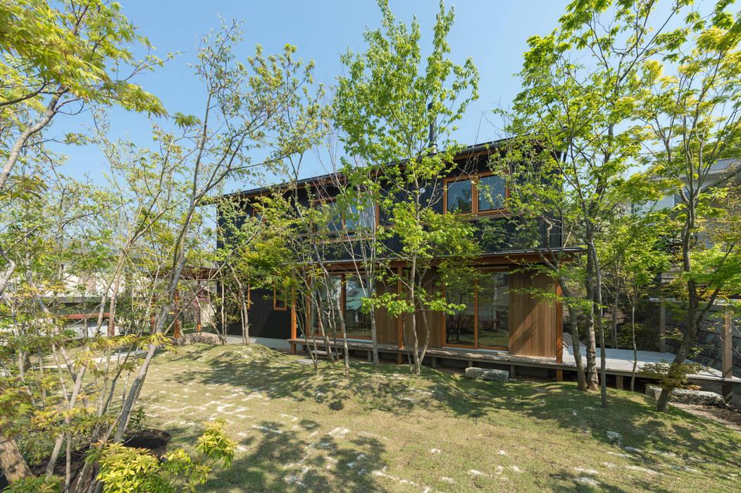 雑木林の庭: 株式会社北村建築工房が手掛けた庭です。