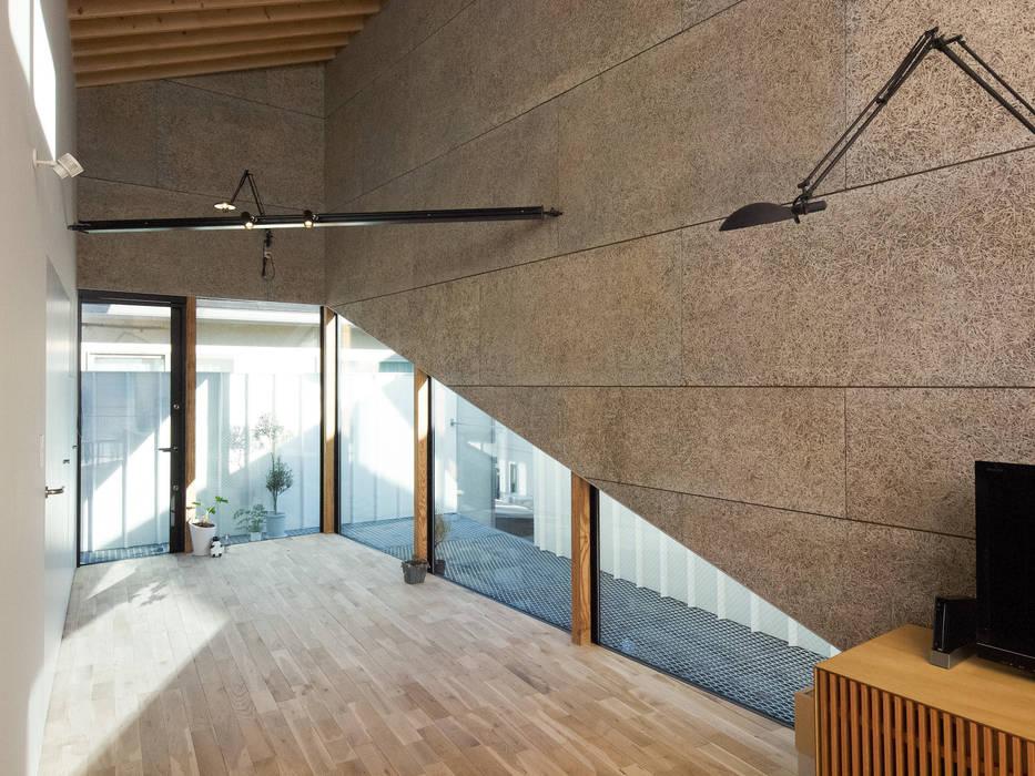 Salas de estilo moderno de atelier CHOCOLATE Moderno