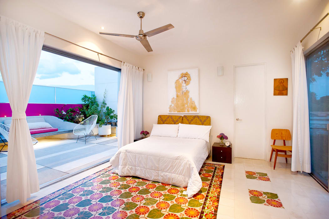 Camera da letto in stile  di Taller Estilo Arquitectura
