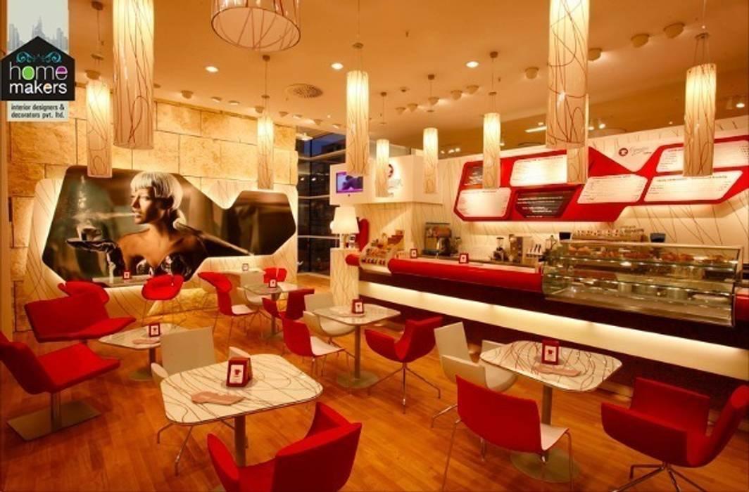 Luxury Café: modern Dining room by home makers interior designers & decorators pvt. ltd.