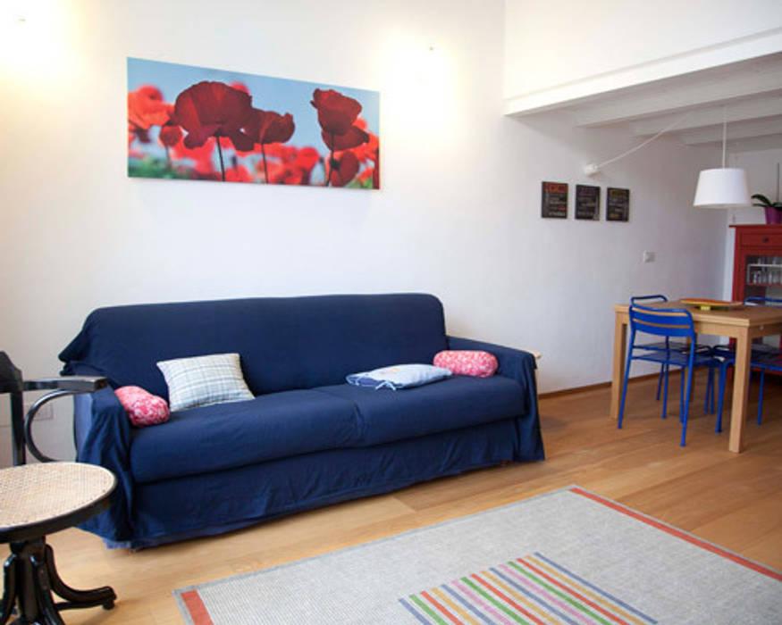 Loft a milano soggiorno in stile di archiexpress homify for Soggiorno a milano