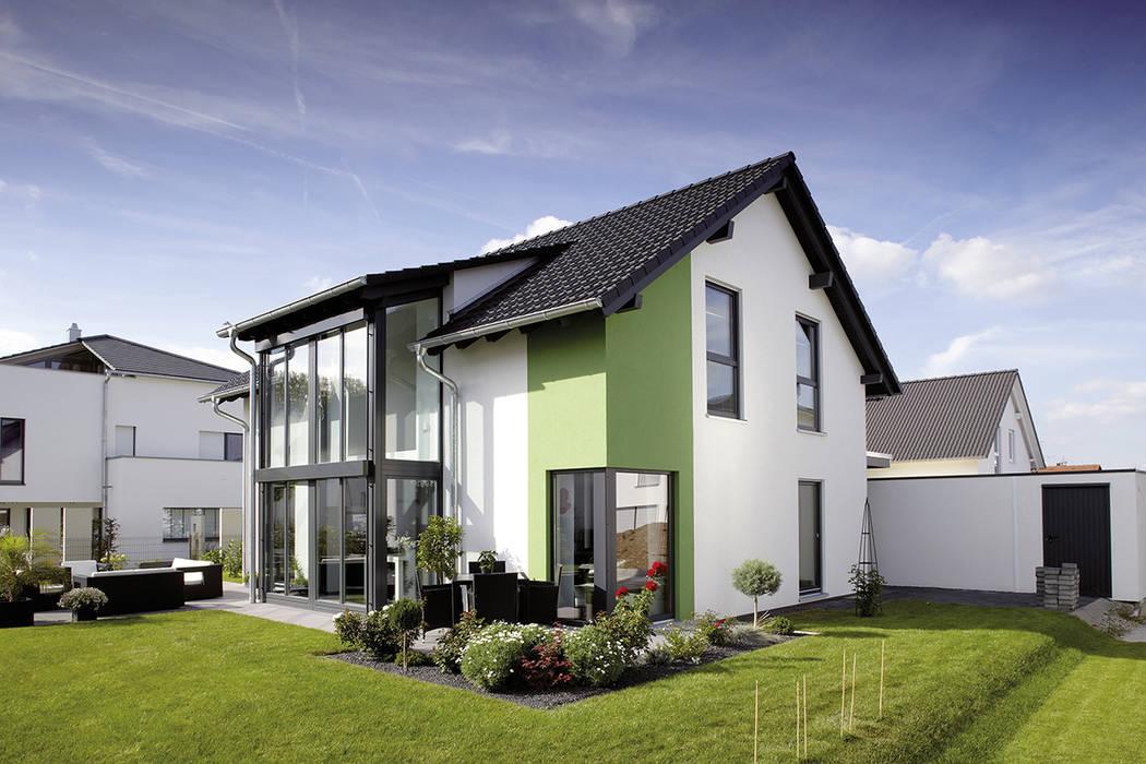 Frei geplantes kundenhaus – einfamilienhaus mit wintergarten und ...