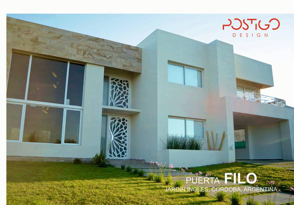 Puerta Filo: Casas de estilo  por Postigo design