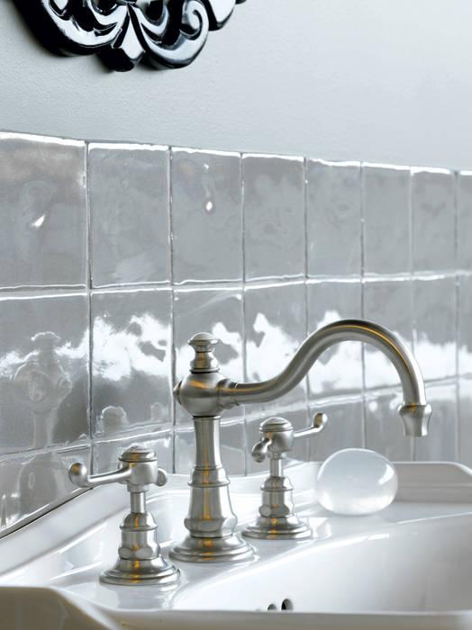 Mélangeur lavabo 3 trous: Salle de bains de style  par HORUS
