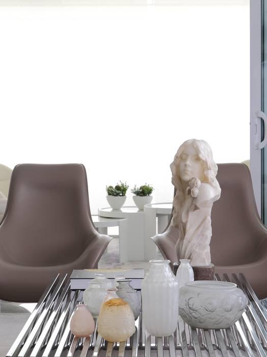 Detalhe sala estar : Salas de estar  por ROMERO DUARTE & ARQUITETOS ,
