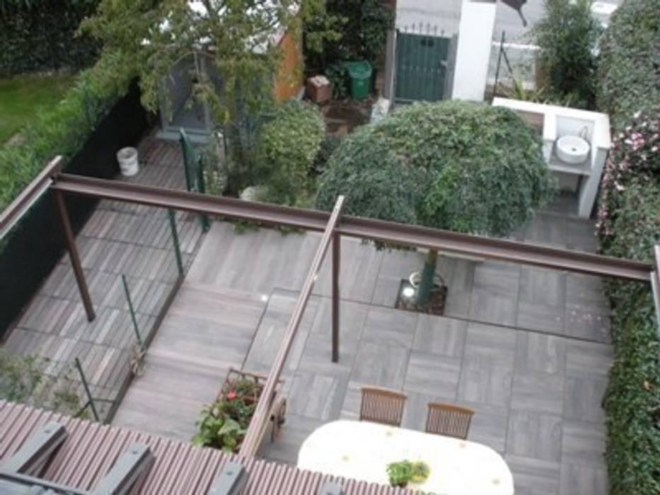 Unico colore, formati diversi: Giardino in stile  di Arch.Susanna Tamborini lapaesaggista.it