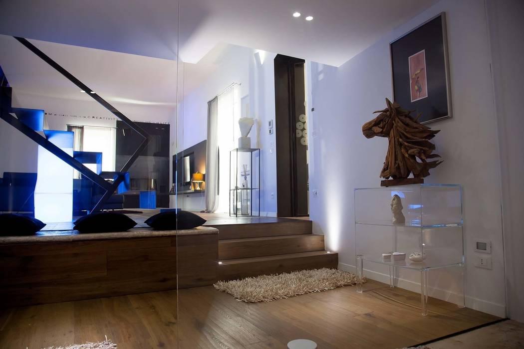 G/G associati studio di ingegneria e architettura _ing.r.guglielmi_arch.a.grossi Minimalist living room