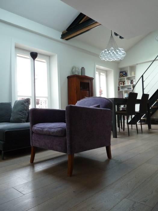 Un salon chaleureux: Salon de style de style Moderne par Thomas JENNY