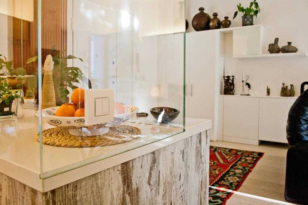 Salas / recibidores de estilo  por GHINELLI ARCHITETTURA ,