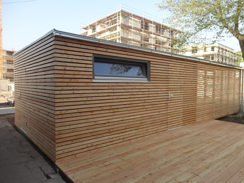 Naturhouse carport+gartenhaus: garage & schuppen von naturmont | homify