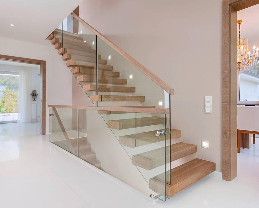 ST920 Nowoczesne schody wspornikowe dębowe / ST920 Modern Floating Oak Stairs: styl , w kategorii Korytarz, przedpokój zaprojektowany przez Trąbczyński