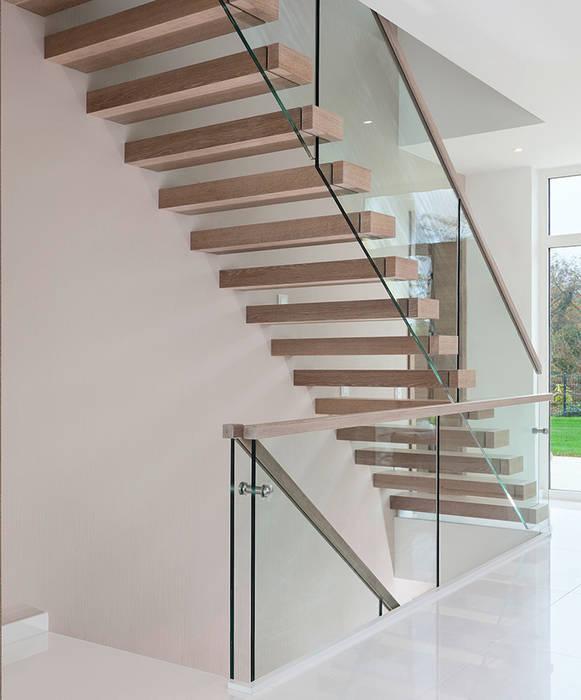 ST920 Nowoczesne schody wspornikowe dębowe / ST920 Modern Floating Oak Stairs: styl , w kategorii Korytarz, przedpokój zaprojektowany przez Trąbczyński,