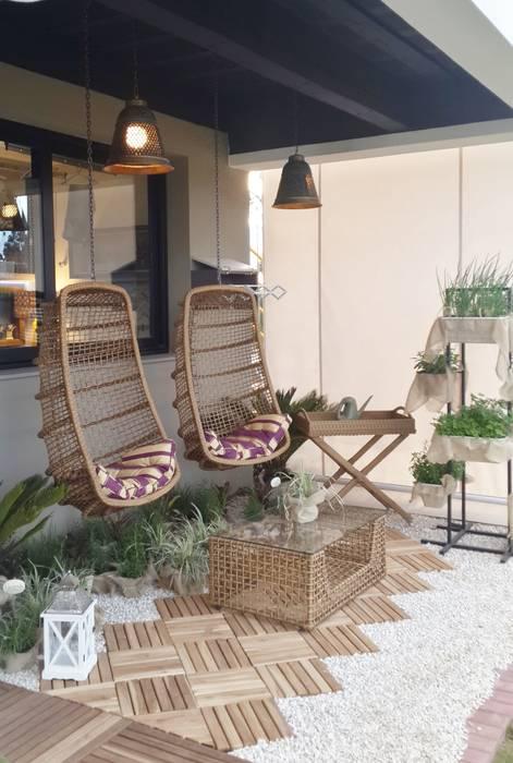 Tropical style garden by Ésse Arquitetura e Interiores Tropical