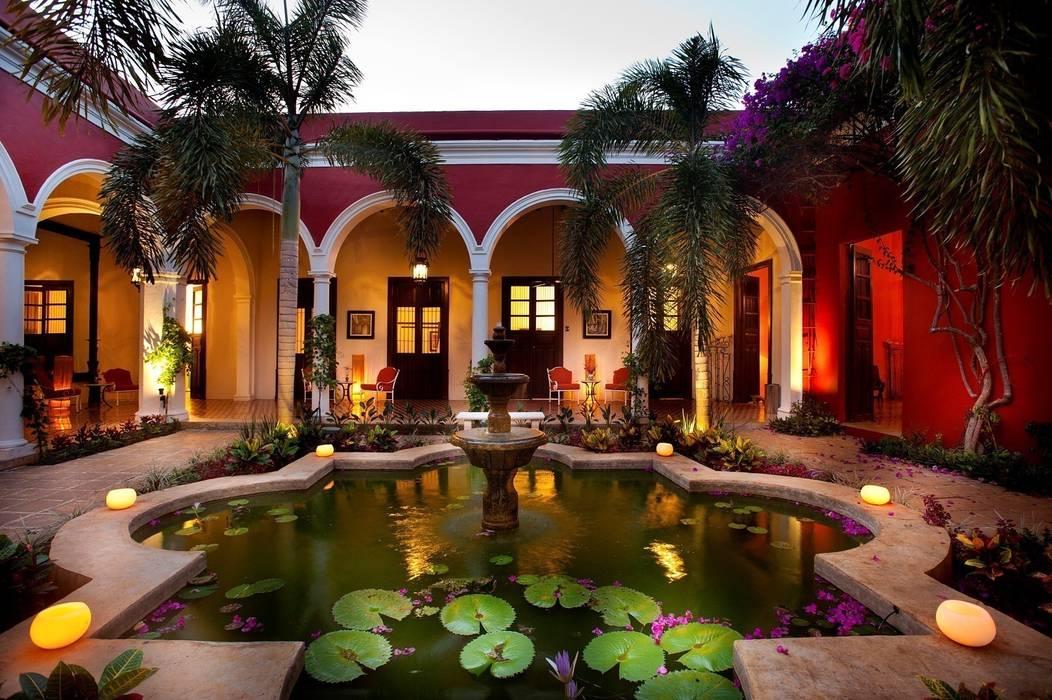 Jardín Central: Hoteles de estilo  por Taller Estilo Arquitectura