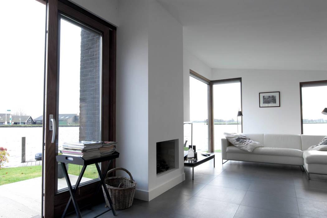 De woonkamer Minimalistische woonkamers van OX architecten Minimalistisch