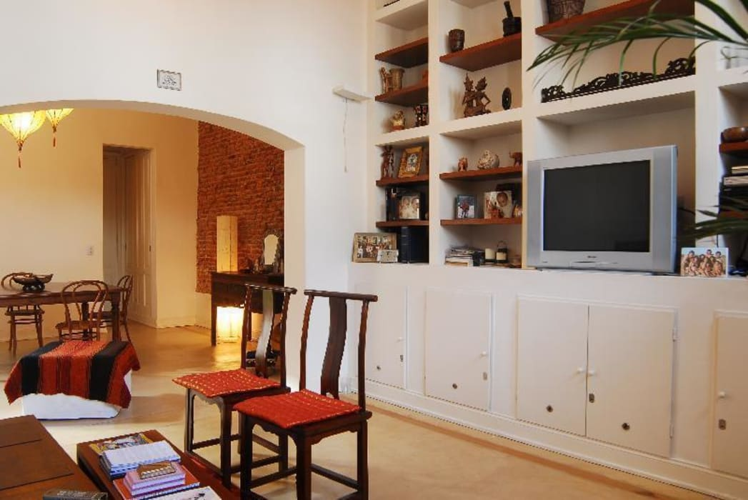 Living después de la reforma: Livings de estilo  por Parrado Arquitectura