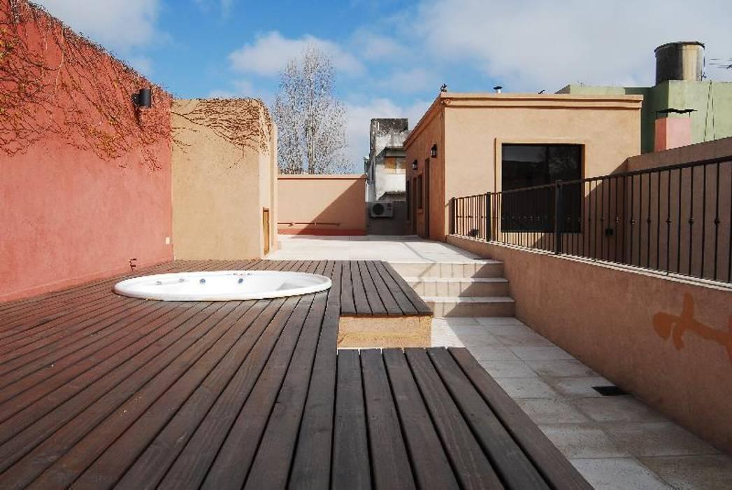 terraza Spa, después : Terrazas de estilo  por Parrado Arquitectura,Ecléctico