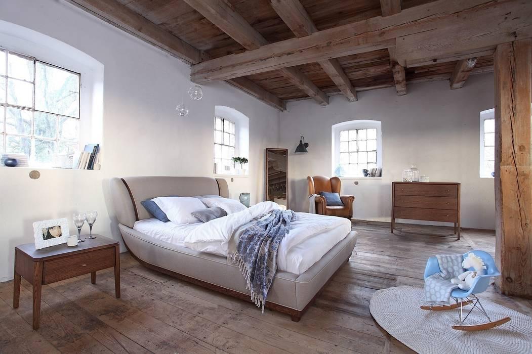 Joy chocolate oak bedroom de Swarzędz Home Escandinavo
