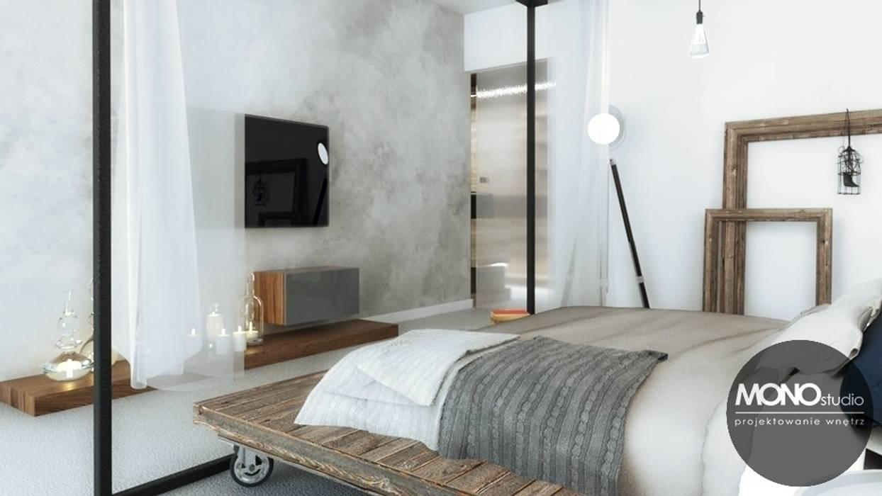 Stylizowana sypialnia z wykorzystaniem surowych materiałów Nowoczesna sypialnia od MONOstudio Nowoczesny