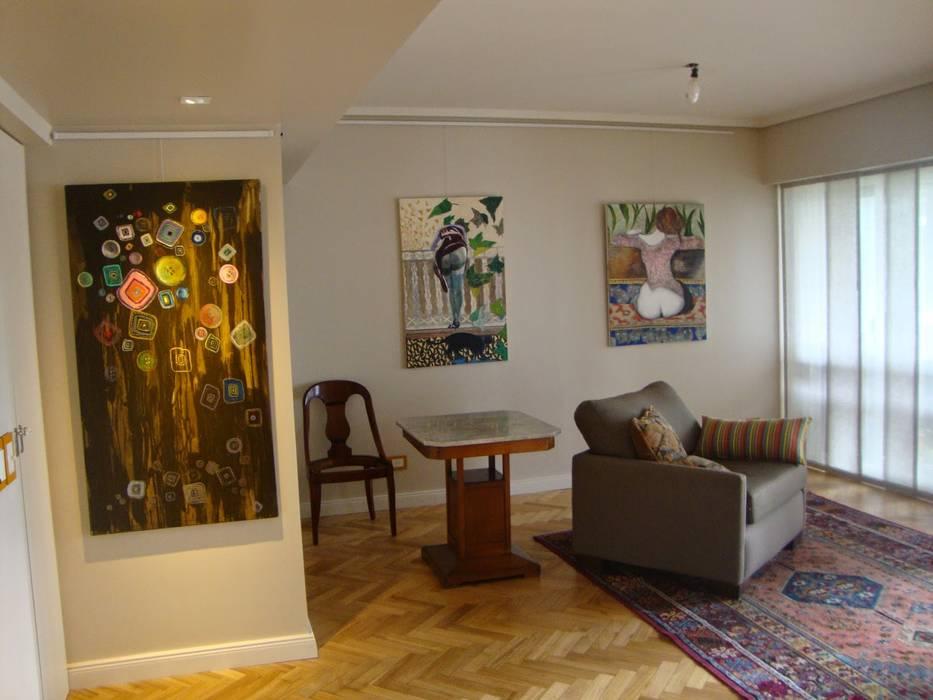Living después de intervención :  de estilo  por Hargain Oneto Arquitectas,
