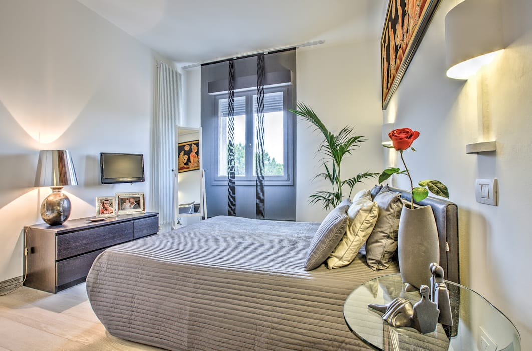 Eclectic style bedroom by GHINELLI ARCHITETTURA Eclectic